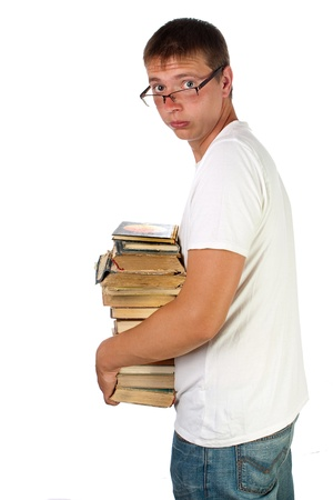 Young male student with glasses looking throuh shoulder and  holding stack of books Stock Photo - 12307000