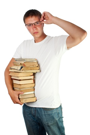 Young male student with spectacles holding stack of books Stock Photo - 12307030
