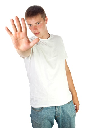 Young man in white t-shirt making stop sign with his hand - isolated on white Stock Photo - 12307002
