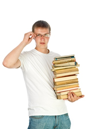 Young male student with glasses  holding stack of books Stock Photo - 12307032