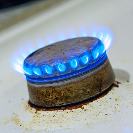 Kitchen gas hob burning closeup photo