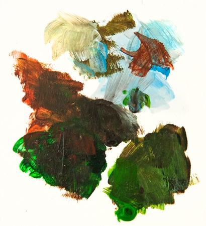 Paint brush strokes and splashes on a white paper photo