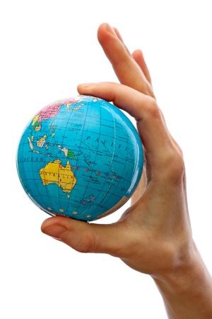 Hand taking a globe isolated photo