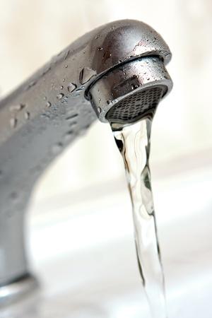 Water running from tap  Macro, shallow dof