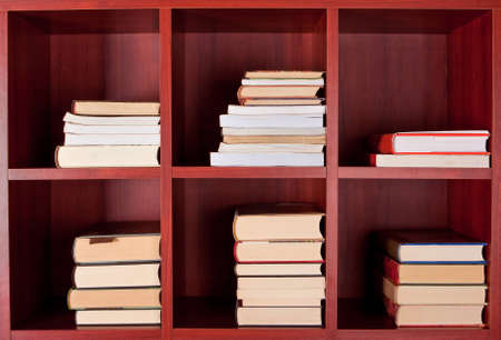 Books on red square bookshelves Stock Photo - 12659473