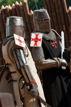 Knight in armour with red crosses Stock Photo - 12659750
