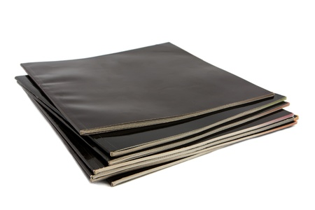 Stack of black covered magazines isolated on white Stock Photo - 13038459