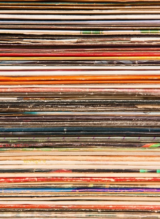 Vertical background of old vinyl covers