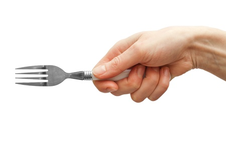 Woman hand holding fork isolated on white  Stock Photo