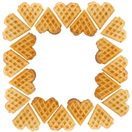 Frame from heart shaped waffles on white background photo