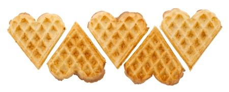 Heart shaped waffles on white background isolated photo