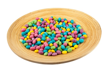 Color candie beans on wooden plate isolated Stock Photo - 13437378