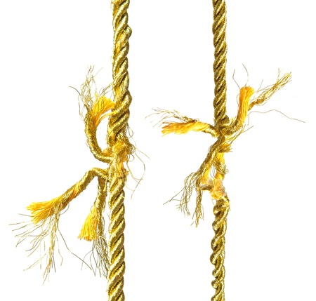 Two torn gold ropes isolated on white Stock Photo - 13532151