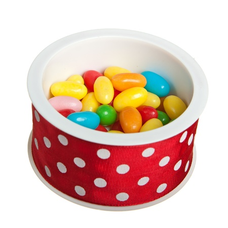Jelly beans in round red box isolated over white Stock Photo - 13658430