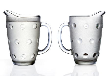 jug: Full and empty glass jugs isolated on white background Stock Photo