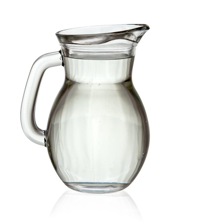 Full of water glass jug isolated on white background