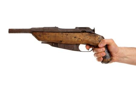 Hand holding old handmade shotgun isolated on white background Stock Photo - 13731005