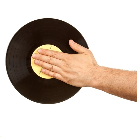 Male hand on vinyl record isolated on white photo