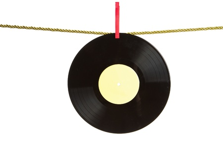 Vinyl record hanged by clothes pin on gold rope isolated on white background