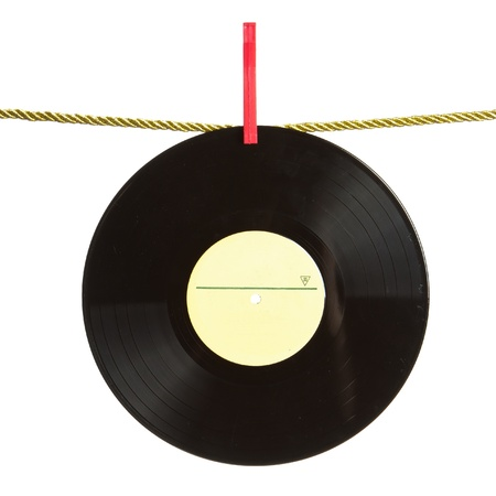 Vinyl record hanged by red clothes pin on gold rope isolated on white background