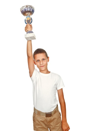 Boy holding sport cup high over the head isolated over white background photo