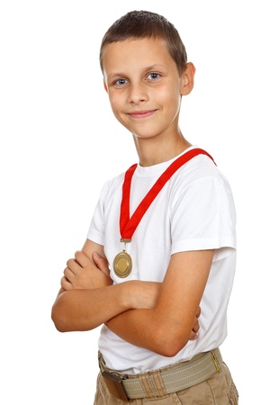 Boy in white shirt proudly smiling with the gold medal  photo