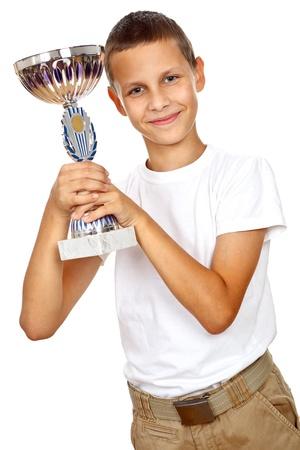 Jongen die sport en lachend geïsoleerd op witte achtergrond Stockfoto
