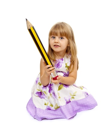 Little girl holding big pencil isolated over white background photo