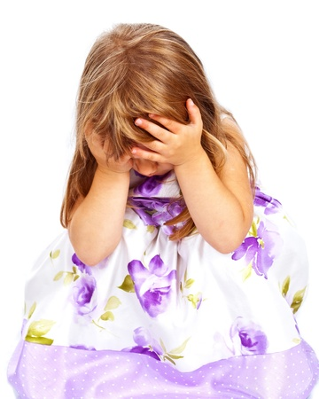 Little girl holding her head with both hands. Chaild abuse, headache, pain, problem concept
