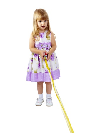 Little girl with measuring tape isolated on white background Stock Photo - 15622525