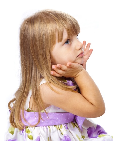 Little beautiful girl holding her head with hands isolated on white photo