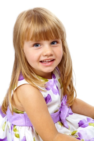Little beautiful girl looking with smile on white background photo