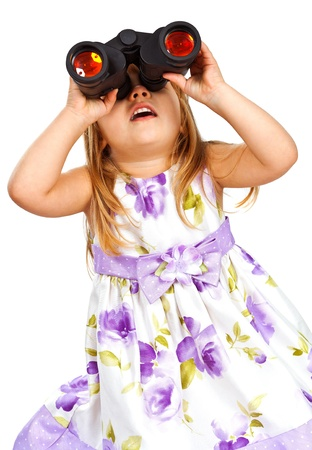 Little girl with binoculars watshing up. Isolated on white background photo