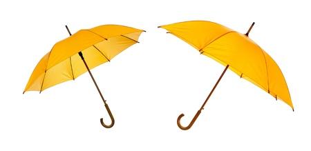 Twee geïsoleerde gele paraplu geopend tegen een witte achtergrond Stockfoto