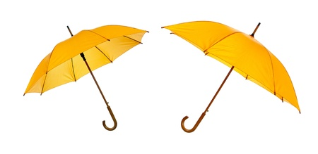 Two opened yellow umbrellas isolated against white background Stock Photo