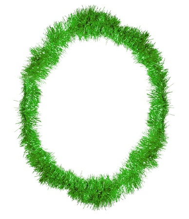 Oval frame of the green Christmas decoration isolated on white photo