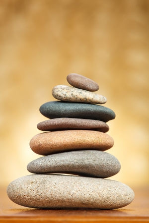 Stack of zen stones over brown background Stock Photo