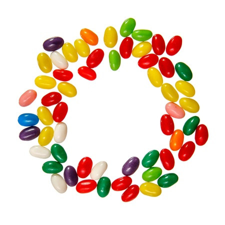 Color jelly beans circle frame isolated over white background Stockfoto