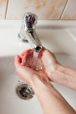 Washing hands under water tap Stock Photo - 16824344