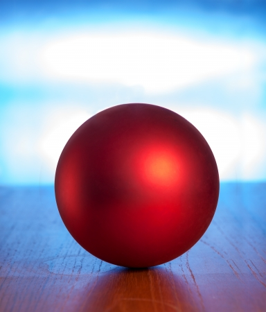 Red ball on table against blue background Stock Photo - 16824181