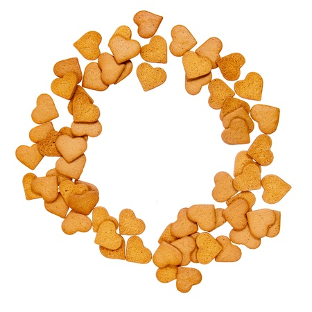 Gingerbread heart shaped cookies put in circle isolated on white photo