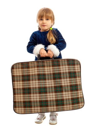lugage: Little girl in blue dress with big old suitcase Stock Photo