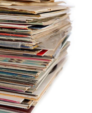 Old vinyl records pile on white background