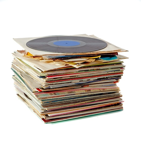 Pile of old dusty vinyl records isolated on white