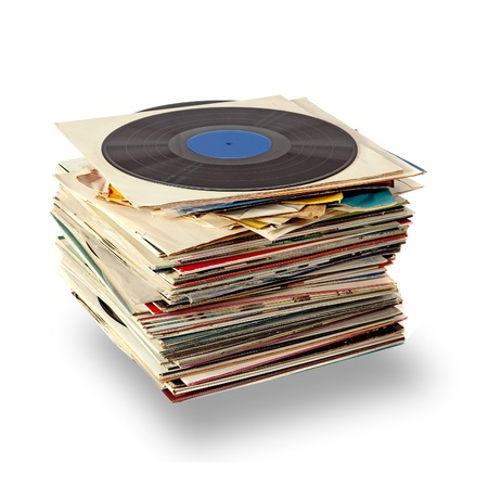 Stack of used vinyl records on white
