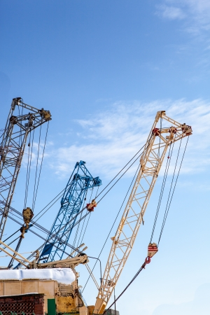 Building cranes on blue sky background Stock Photo - 19015657
