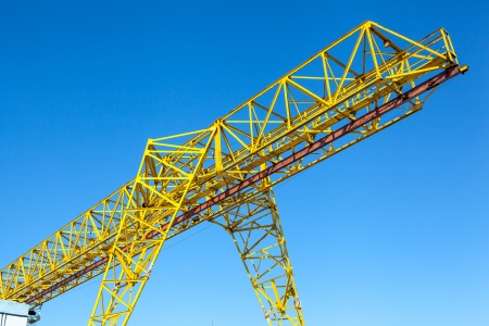 Yellow gantry crane over bright blue sky Stock Photo - 19015661