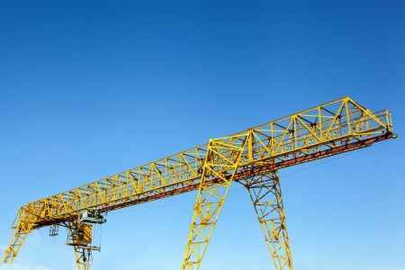 Yellow gantry crane over bright blue sky Stock Photo - 19015653