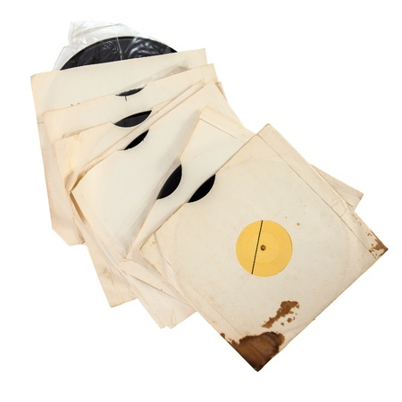Old vinyl records in paper covers isolated over white photo