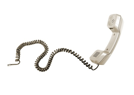 Vintage telephone receiver with cable isolated over white Reklamní fotografie